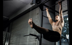 7 Different Pull-Up Bar Exercises You Can Do With Nothing But a Bar